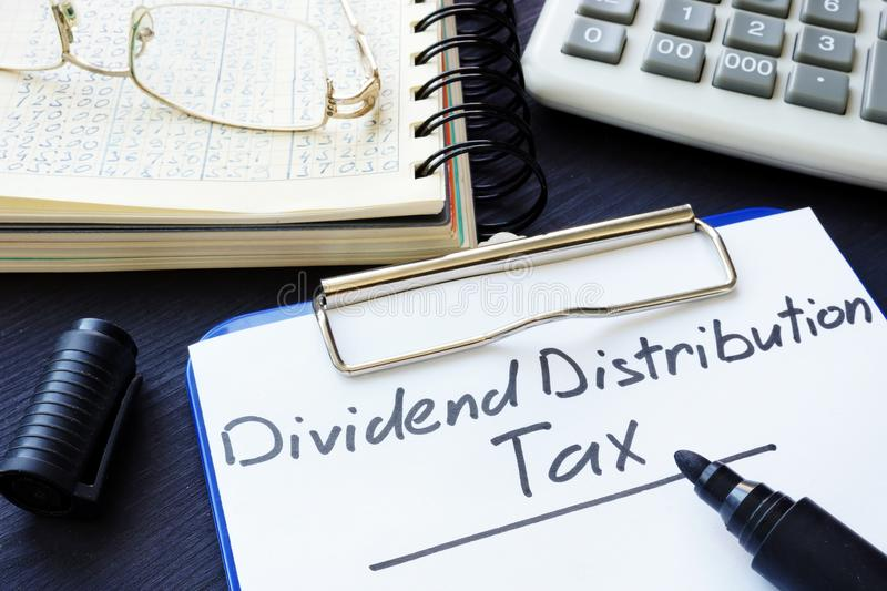Dividend Distribution Tax DDT written on the sheet of paper. Dividend Distribution Tax DDT written on a sheet of paper stock photos