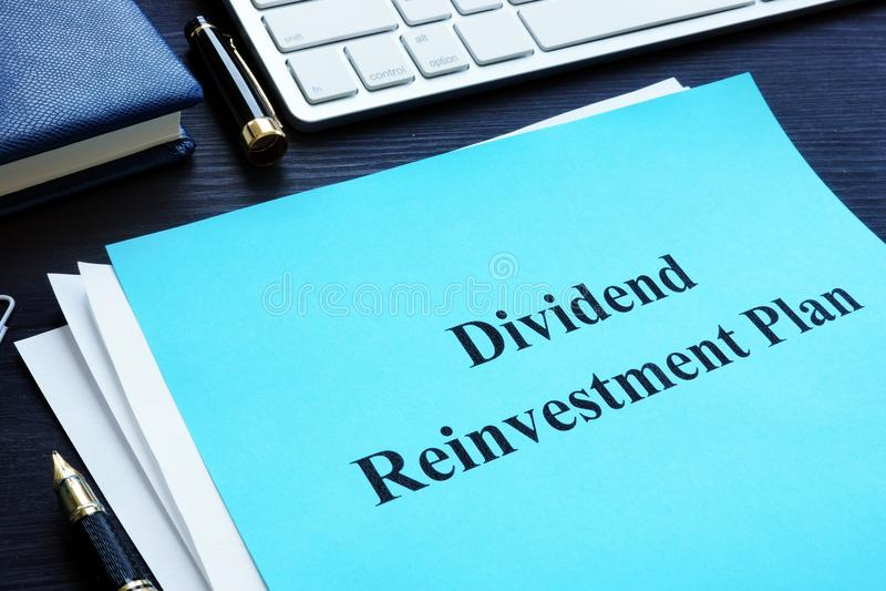 Dividend Reinvestment Plan - DRIP on a desk. Dividend Reinvestment Plan - DRIP on the desk royalty free stock photos