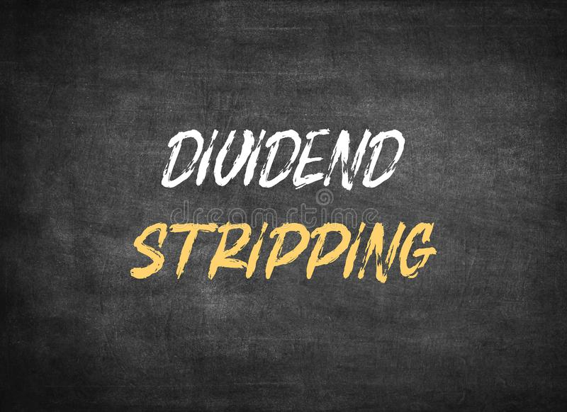 Dividend Stripping. On chalkboard background stock photo