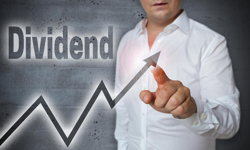 Dividend touchscreen is operated by man.  royalty free stock photos