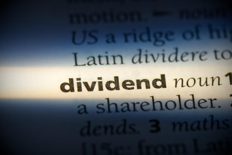 Dividend. Word in a dictionary.  concept stock photo