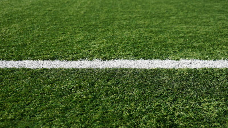 Dividing the white stripe on the football field royalty free stock photos