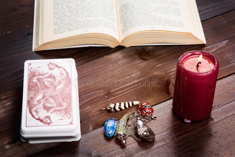 Divination and fortune-telling vintage. Composition of esoteric objects,candle,cards and book used for healing and fortune-telling stock images