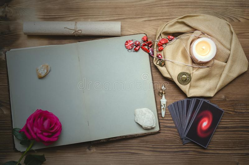 Divination. Tarot cards. Fortune teller. Tarot cards deck and open book of magic with copy space on fortune teller desk table bakground. Future reading concept royalty free stock photography