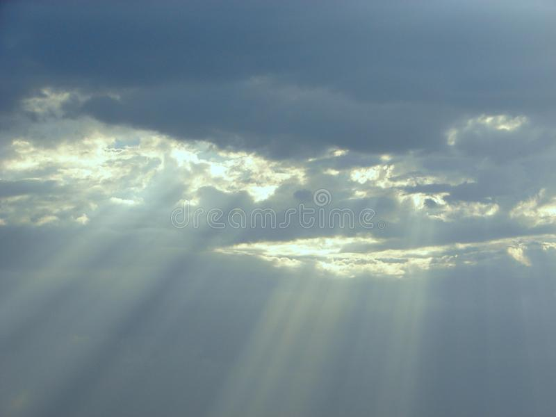 Divine Blessings from Sky - Sun Rays through Clouds royalty free stock image