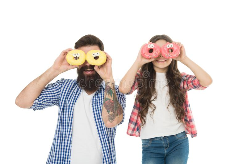 The divine donut baking class. Bearded man and little girl child smiling with fresh doughnuts after baking. Happy family stock images