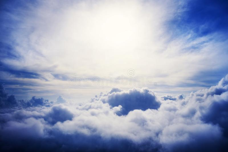 The divine sky. View of the blue sky from the aircraft. Big Cumulus clouds. Cloudy weather. Ominous cloud. Bad weather stock photo
