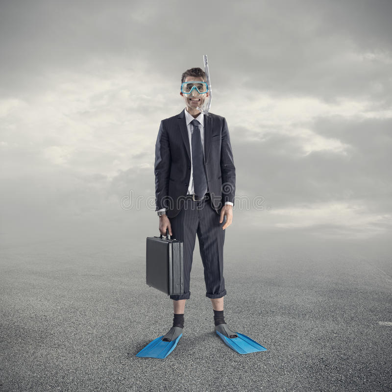 Diving businessman. Businessman wearing scuba mask and flippers stock image