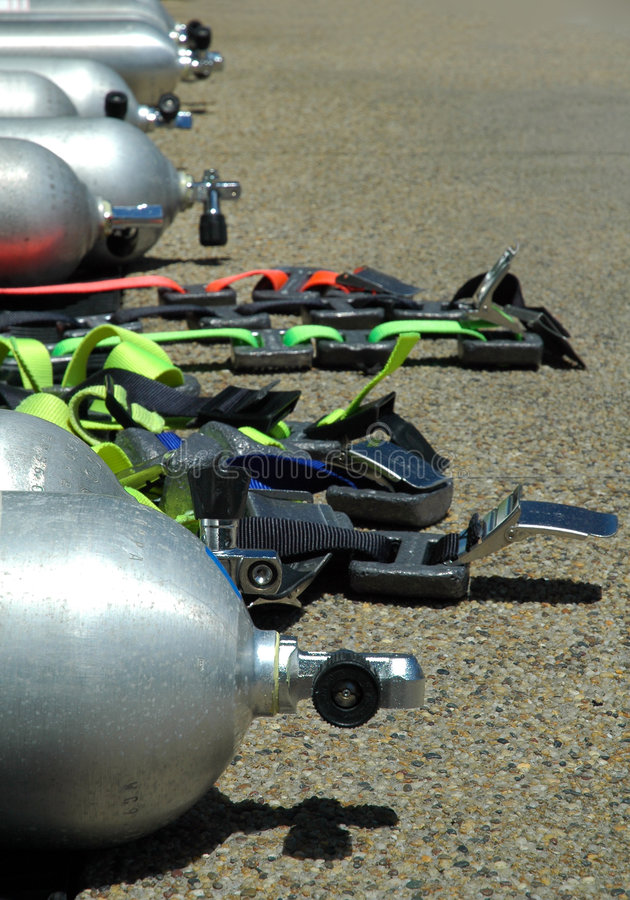 Diving equipment. Air cylinders, weight belts, distance blurring royalty free stock photo