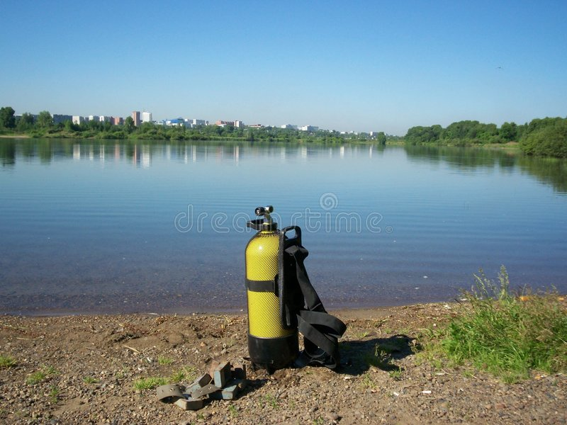 Diving equipment on lake shore stock images