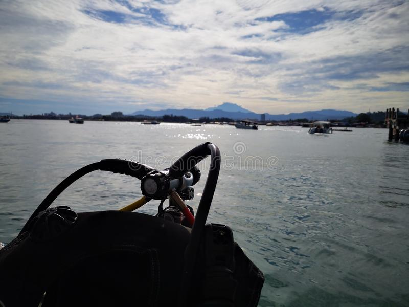 Diving equipments with Mount Kinabalu background in Tunku Abdul Rahman Park, Kota Kinabalu. Sabah, Malaysia. Borneo. Diving equipments and ready to dive with royalty free stock image