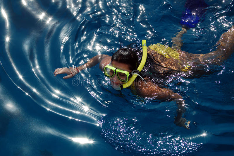 Diving girl in the sea royalty free stock images
