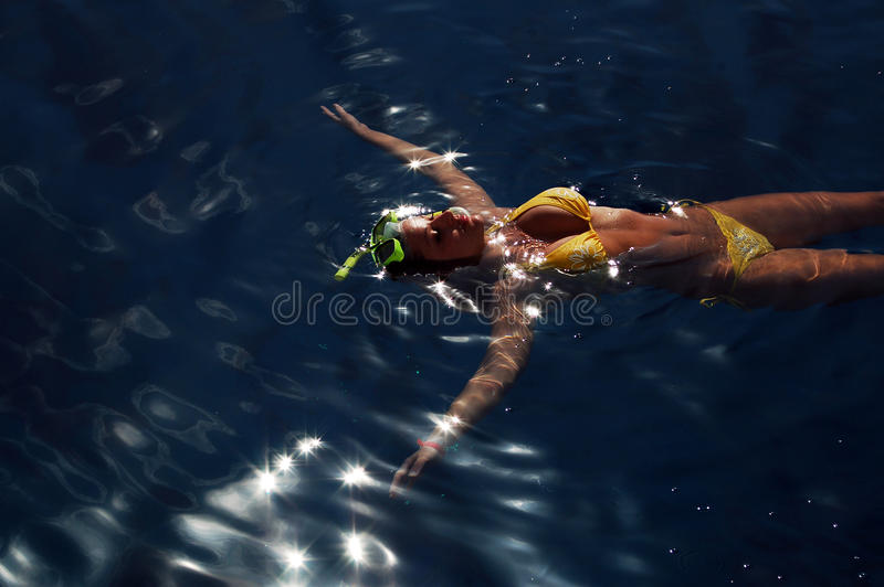 Diving girl in the sea surface stock photos