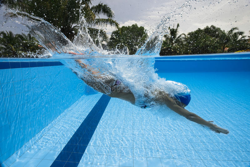 Diving into swimming pool stock photography
