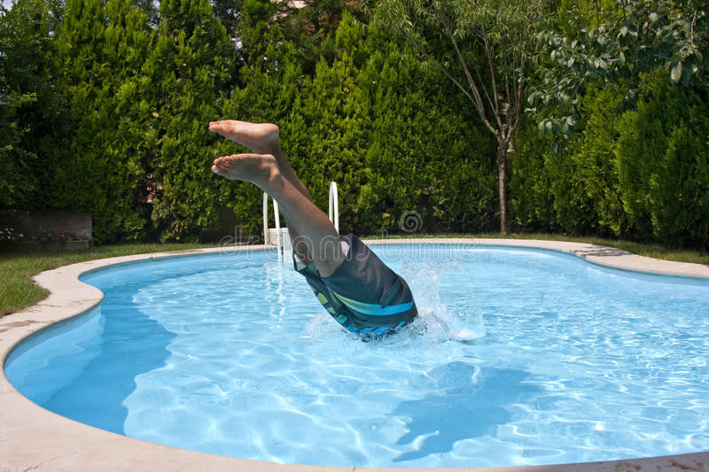 Diving to pool stock photos