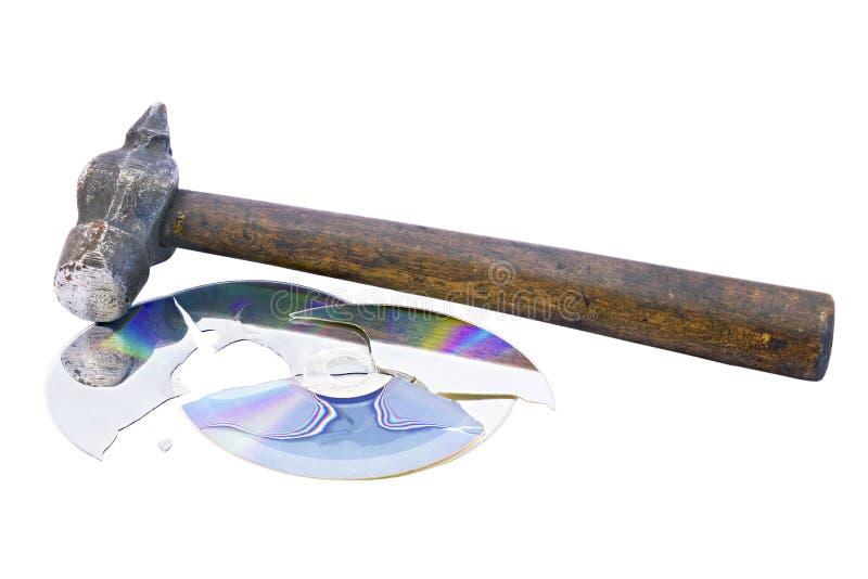 Divisé en parties cd le disque et le marteau photographie stock libre de droits