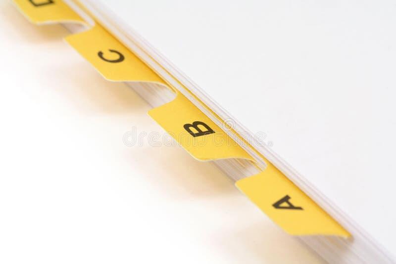 Divisor amarillo del fichero foto de archivo
