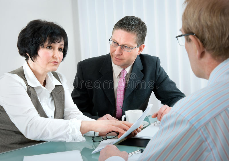 Divorce. Woman and her lawyer in conversation with husband during divorce process