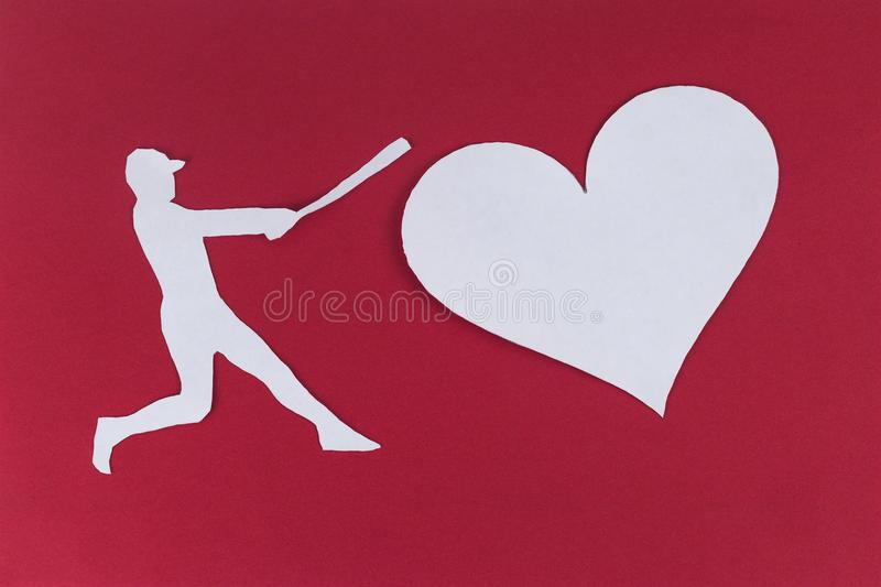 Baseball player hitting a heart. Divorce break up concept royalty free stock photo