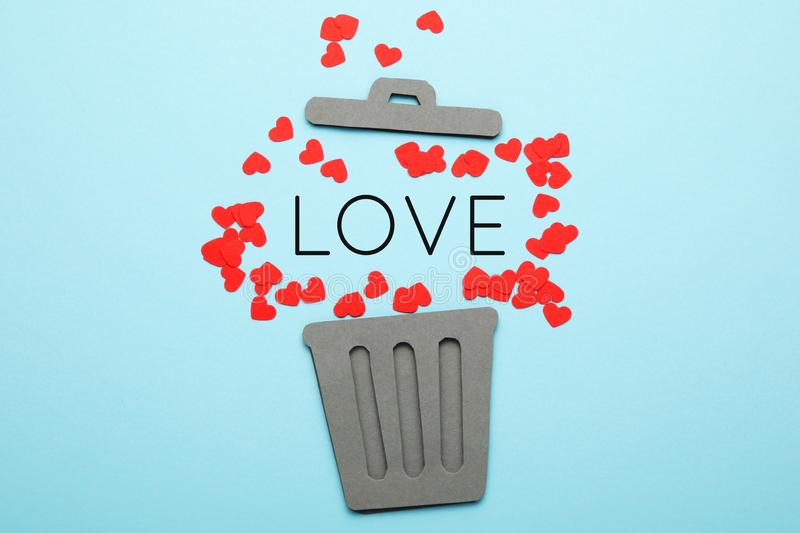 Divorce of couple,  red hearts in trash can. Love and hatred, separation stock photos