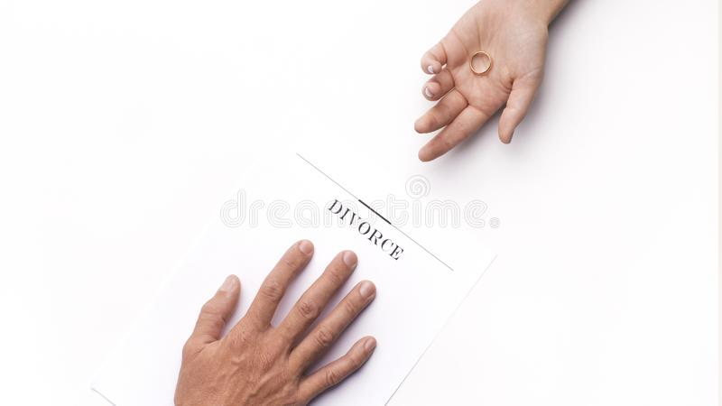 Divorce decision between two people, woman holding ring royalty free stock image