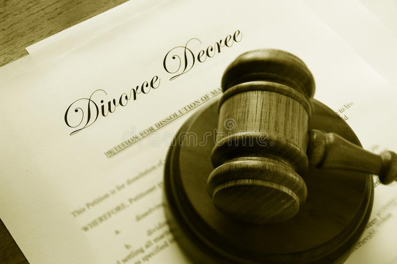 Divorce papers and gavel. Legal gavel on top of divorce papers royalty free stock photos
