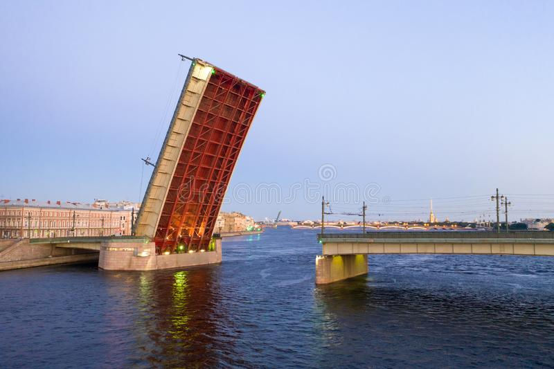 The divorced Liteyny Bridge in the early June morning. White nights in St. Petersburg. Russia royalty free stock image