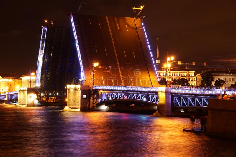 Divorced Palace Bridge in St. Petersburg over the Neva River at night with illumination stock photography