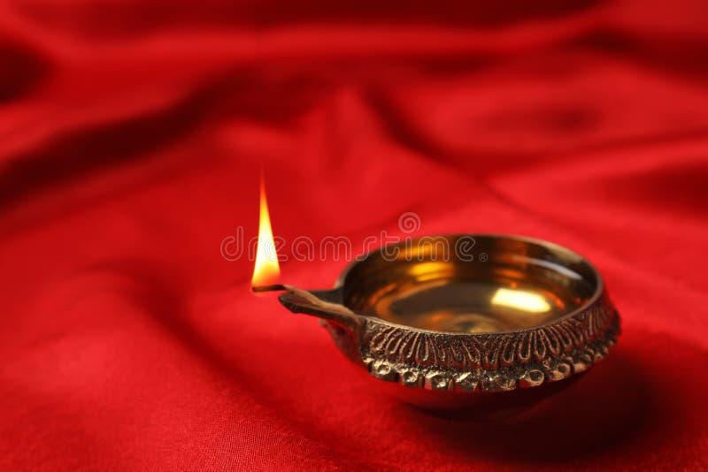 Diwali diya or clay lamp. On color fabric stock photos