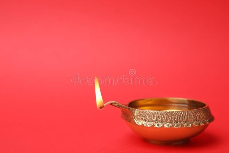 Diwali diya or clay lamp. On color background royalty free stock photos