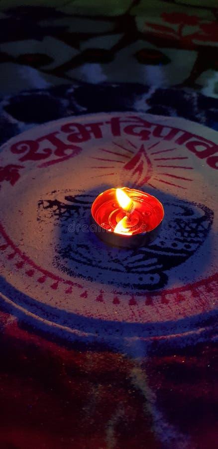 The diwali diya. The diya on rangoli looks beautiful stock photos