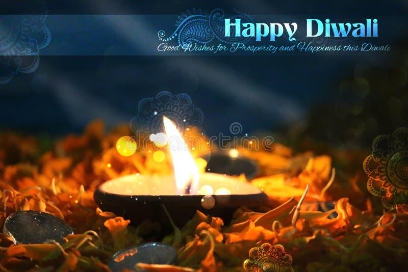 Diwali diya på blommarangoli royaltyfri foto