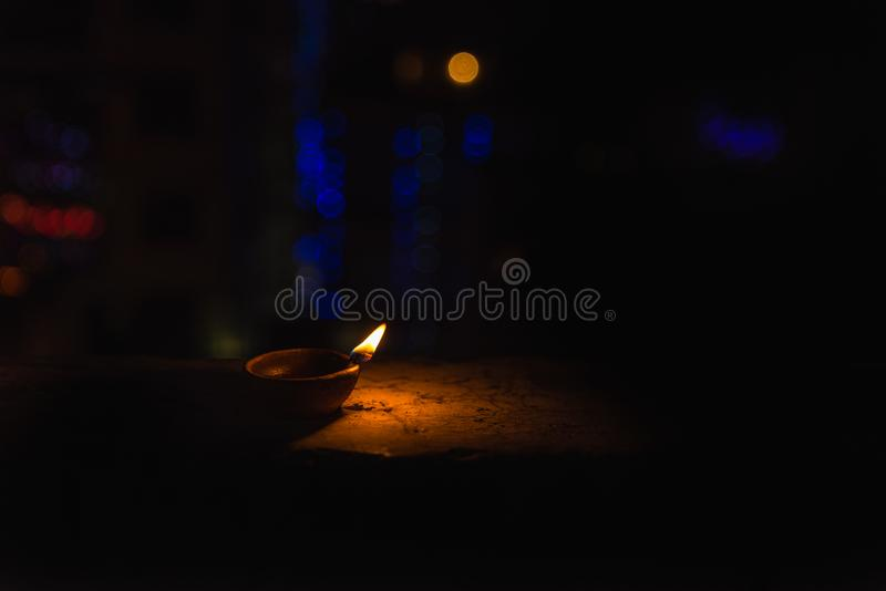 Diwali Light in dark background. Diwali light using traditional diwa made of earth soil in bokeh stock photo