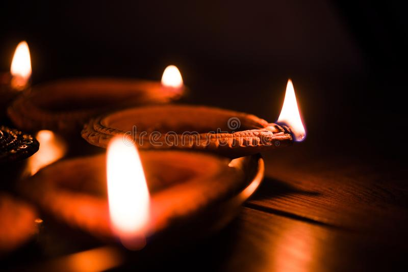 Diwali oil lamp or diya in a brass plate. Diya in Thali - Brass Plate or thali full of Terracotta diya or oil lamps ready for decorating or illuminating house on royalty free stock photo