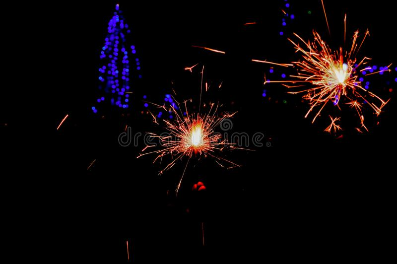 diwali small hand fireworks and beautiful black and lighting background, Close up of man hands holding sparkler,diwali lighting, royalty free stock photo