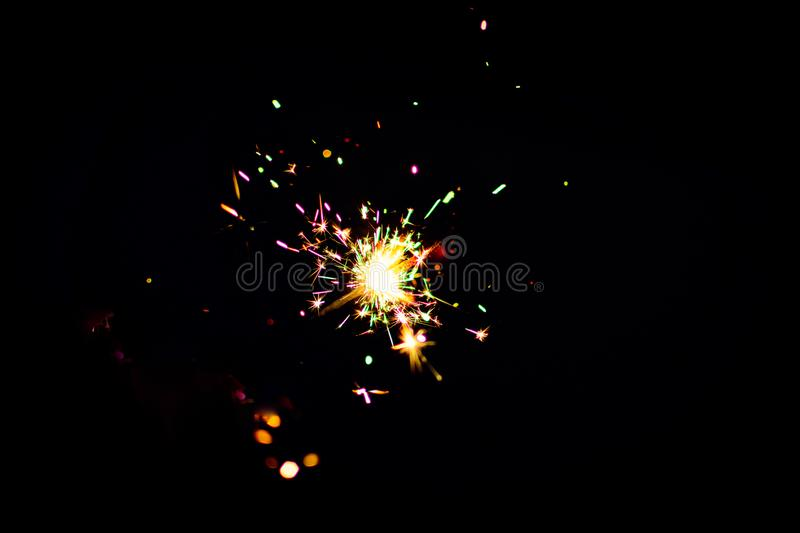 diwali sparkling crackers in black background for Social media template royalty free stock photo