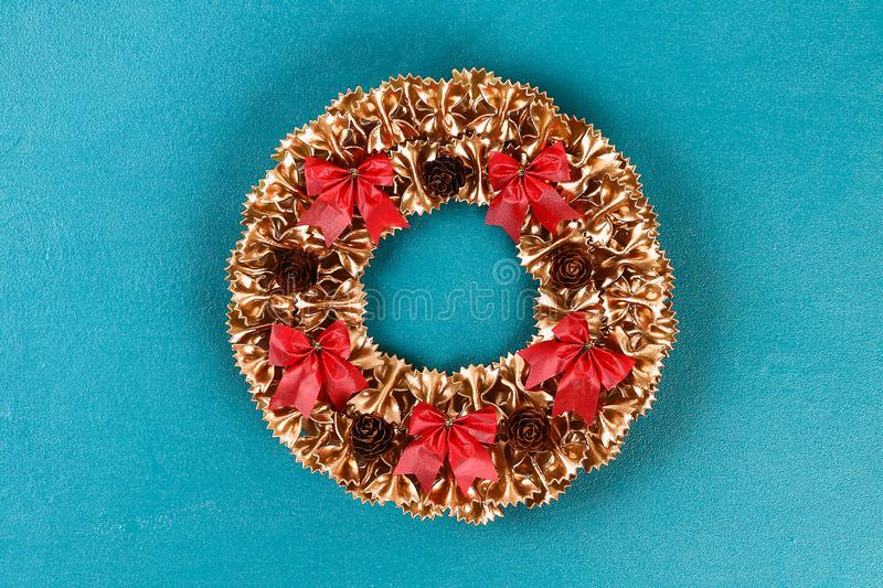 Diy Christmas pasta wreath on blue background. Gift idea, decor Christmas, Xmas, New Year stock image