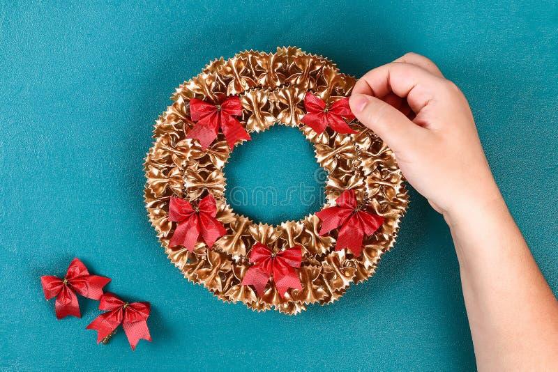 Diy Christmas pasta wreath on blue background. Gift idea, decor Christmas, Xmas, New Year stock photography