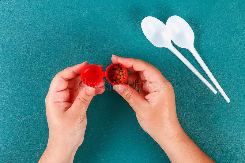 Diy cinco de mayo maracas from eggs, spoons and cereals on a green background stock images