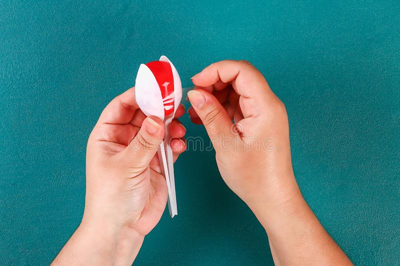 Diy cinco de mayo maracas from eggs, spoons and cereals on a green background stock photography