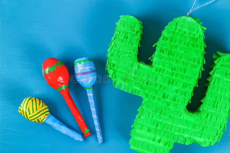 Diy cinco de mayo Mexican Pinata Cactus made cardboard, crepe paper your own hands blue background. Diy cinco de mayo Mexican Pinata Cactus made cardboard and royalty free stock photos