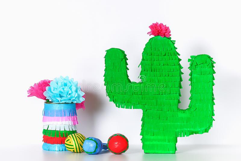 Diy cinco de mayo Mexican Pinata Cactus made cardboard, crepe paper your own hands blue background. Diy cinco de mayo Mexican Pinata Cactus made cardboard and royalty free stock image