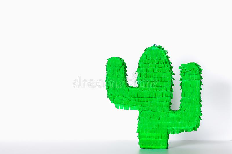 Diy cinco de mayo Mexican Pinata Cactus made cardboard, crepe paper your own hands blue background. Diy cinco de mayo Mexican Pinata Cactus made cardboard and royalty free stock photography