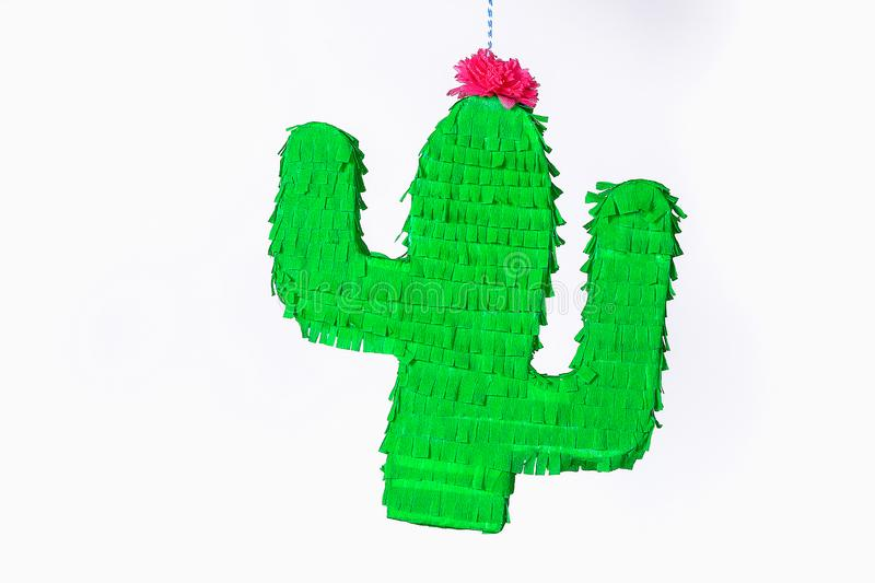 Diy cinco de mayo Mexican Pinata Cactus made cardboard, crepe paper your own hands blue background. Diy cinco de mayo Mexican Pinata Cactus made cardboard and stock images