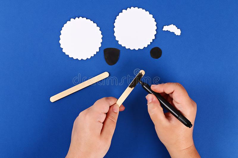 Diy Eid al adha lamb sheep sweet candy paper, wooden sticks for ice cream on blue background royalty free stock photo