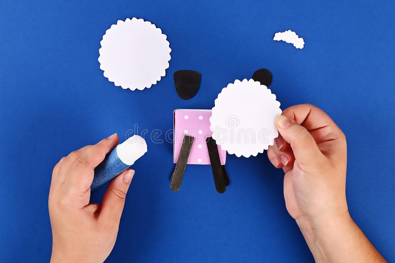 Diy Eid al adha lamb sheep sweet candy paper, wooden sticks for ice cream on blue background stock photos