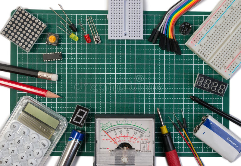 DIY electrical maker tools components on green cutting mat board. DIY electrical maker tools with copy space for text on green background. DIY electrical royalty free stock photos