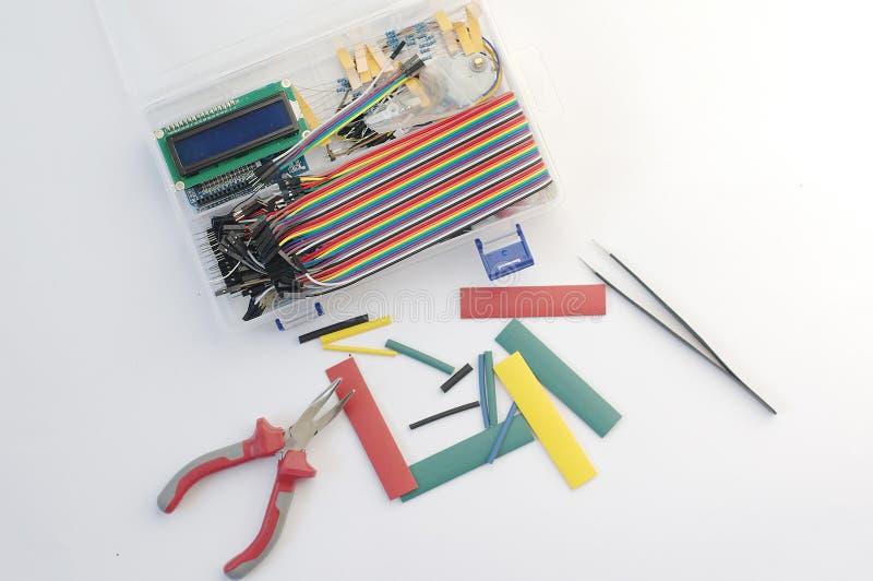 DIY electronics hobby kit opened heatshrink laying around on the grey background. DIY engineer electronic kit set. royalty free stock photos