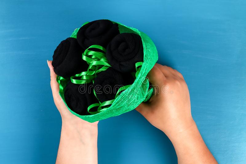 Diy father's day bouquet black roses socks blue background. Gift idea, decor Father day, Daddy. 12 Diy father's day bouquet black roses socks blue background royalty free stock photo