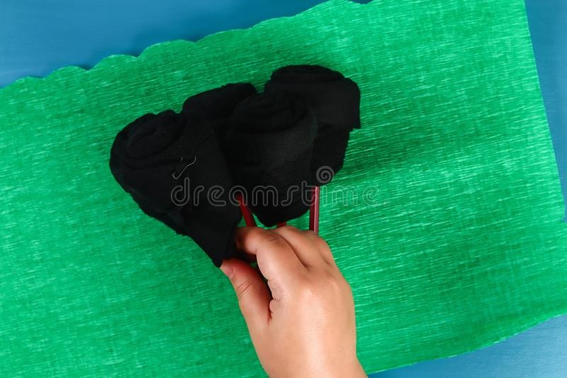 Diy father's day bouquet black roses socks blue background. Gift idea, decor Father day, Daddy. 8 Diy father's day bouquet black roses socks blue background royalty free stock photo